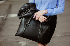 Business style clothing. black bag and stilish sunglasses Royalty Free Stock Photography