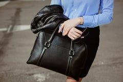 Business style clothing. black bag and stilish sunglasses. Business style clothing. fashion details, caucasian business woman holding  black bag and stilish Royalty Free Stock Photography