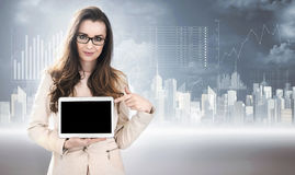 Business style photo of a woman holding a tablet. Business style photo of a lady holding a tablet Royalty Free Stock Photo
