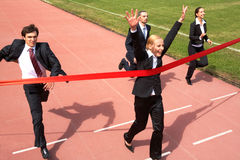 Business success. Photo of happy businesswoman crossing finish line during race Royalty Free Stock Photography