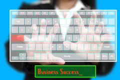 Business Success. Business Woman typing Success on Technology Virtual Keyboard Royalty Free Stock Photography