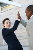 Business Success. Two attractive business people celebrating a success Royalty Free Stock Image