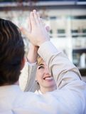 Business success. Business man and woman give a high-five Royalty Free Stock Photos