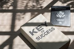 Business of success book and passport near window in the morning royalty free stock photography