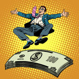 Business success businessman money trampoline. Pop art retro style. Financial wealth income of a millionaire. Cash prize. Stack of dollars Royalty Free Stock Photo