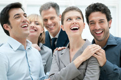 Business success and celebration. Happy business team smiling and laughing together at office to celebrate a success Stock Photography
