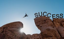 Free Business Success, Challenge, Achievement And Leadership Concept. Silhouette A Man Jumping Over Precipice To Success Royalty Free Stock Images - 135538779