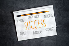 Business Success Components in Notebook Stock Image