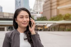 Business success concept : business women call smartphone ,succe. Business success concept : business woman call smartphone ,successful smile ,selective focus Royalty Free Stock Photography