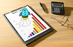Business success concept on a desk. Business success concept on a clipboard with a calculator Royalty Free Stock Photography