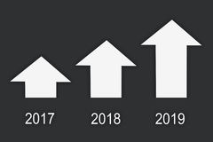 Business success concept and growth idea. 2017 to 2019 and three white arrow on grey background, business success concept and growth idea Stock Image