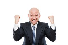 Smiling businessman winner gesturing raised hands fist celebrating victory achievement Stock Images