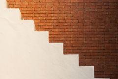 Business Success Concept : Side view of white empty stairs with brown brick wall background. Stock Photo
