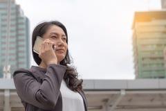 Business success concept : business women call smartphone ,succe. Business success concept : business woman call smartphone ,successful smile ,selective focus Stock Photos