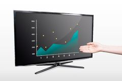Hand showing chart on modern TV screen Stock Photos