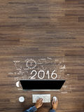 Business success 2016 new year. Creative thinking drawing charts and graphs strategy plan ideas wooden table background, Inspiration concept with businessman Stock Photography