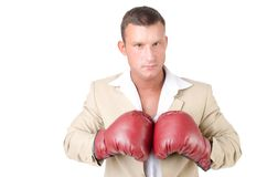 Business and success. Office fight. Young man in boxing gloves. Work and the battle. White background. Power and sexy. Fitness and healthy lifestyle. Sport and Royalty Free Stock Image