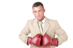 Business and success. Office fight. Young man in boxing gloves. Work and the battle. White background. Power and sexy. Fitness and healthy lifestyle. Sport and Royalty Free Stock Photo