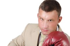 Business and success. Office fight. Young man in boxing gloves. Work and the battle. White background. Power and sexy. Fitness and healthy lifestyle. Sport and Stock Images