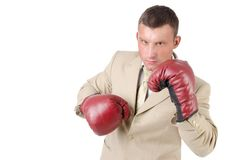 Business and success. Office fight. Young man in boxing gloves. Work and the battle. White background. Power and sexy. Fitness and healthy lifestyle. Sport and Stock Photo