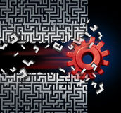 Business Success Solution. Concept as a machine gear or mechanical cog breaking through a maze or labyrinth as a metaphor for disruptive technology or ground Royalty Free Stock Image