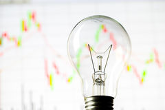 Business success with stock graph and light bulb Royalty Free Stock Image
