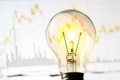 Business success with stock graph and light bulb Stock Photo