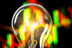 Business success with stock graph and light bulb Royalty Free Stock Photography