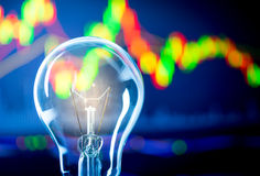 Business success with stock graph and light bulb Stock Photos