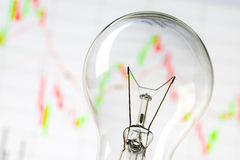 Business success with stock graph and light bulb. Stock graph and light bulb lighting in studio with softbox Stock Images