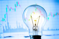 Business success with stock graph and light bulb Royalty Free Stock Images