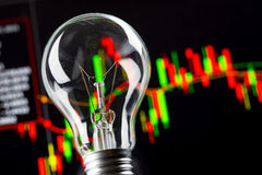 Business success with stock graph and light bulb Royalty Free Stock Photos