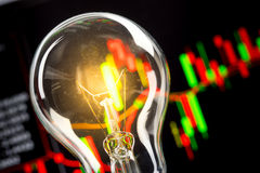 Business success with stock graph and light bulb Stock Image