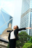 Business success with successful woman, Hong Kong. Business success with successful woman in Hong Kong celebrating business achievements with arms spread out Stock Photos