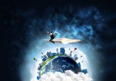 Business success and targets achievement concept. Conceptual image of young businessman in suit flying on rocket with planet Earth and open space on background Stock Image