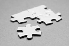 Business success team in jigsaw. Lighting in studio Stock Images
