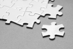 Business success team in jigsaw. Lighting in studio Royalty Free Stock Images