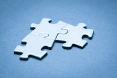 Business success team in jigsaw. Lighting in studio Royalty Free Stock Image