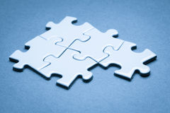 Business success team in jigsaw. Lighting in studio Royalty Free Stock Photography