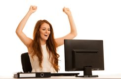 Business success - woman gestures victori with her arms up in th. E office isolated over white background Royalty Free Stock Photography