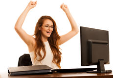 Business success - woman gestures victori with her arms up in th. E office isolated over white background Stock Image