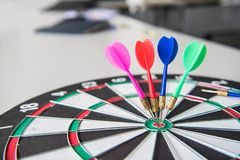 Business successful and goal concept. With dart board game stock image