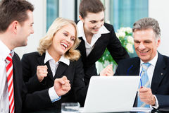 Business - successful meeting in an office. Business - colleagues have a successful meeting in an office stock photo
