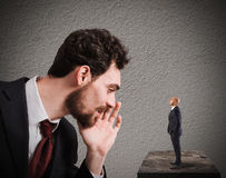 Business suggestion for work problems. Businessman speaks whispering to a small man. Business suggestion  concept Royalty Free Stock Photography