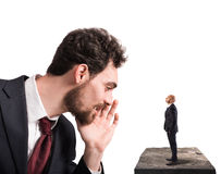 Business suggestion for work problems. Businessman speaks whispering to a small man. Business suggestion  concept Stock Photo