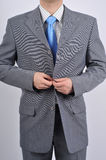 Business suit. Image of businessman doing a suit Royalty Free Stock Photography