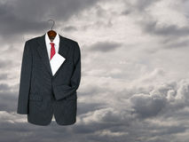 Business suit hung up with envelope - will, inheritance metaphor Royalty Free Stock Image