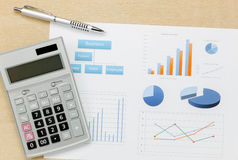 Business summary of the year and pen, chart calculator Stock Photography