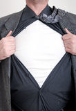 Business superhero. A business man tears open his shirt in a super hero fashion getting ready to save the day Stock Image