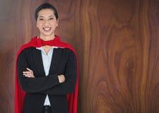 Business Superhero against wood Stock Images